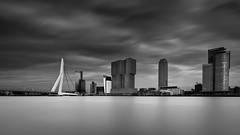 Rotterdam skyline (miguel_lorente) Tags: netherlands bridge street bnw city cityscape clouds silky nd building erasmus blacknwhite longexposure modern bw rotterdam blackandwhite sky water architecture