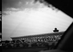 Arriving at Dulles (Riverman___) Tags: usa building film window architecture virginia washington airport dulles iad twilight nikon kodak dusk tmax voigtlander 400 f2 40mm saarinen eero f6 slii bwfp
