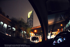 Passing by (YZEED) Tags: world city light tower night nikon flickr day view nightshot kingdom rainy saudi arabia riyadh saudiarabia 2012 ksa kingdomtower yazeed  alkhulaifi  d300s