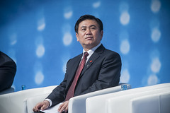 Zhenglin Feng participates in a panel at the Annual Summit