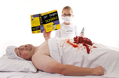 Surgery for Dummies (simon.anderson) Tags: portraits hospital book nikon dummies flash knife humour surgery patient medical help doctor nhs sausages surgical scared medic operation headache guts notreal intestines donttrythisathome gory selfie procedure operate 1685 offcameraflash strobist simonanderson d300s juniordoctor yongnuorf602