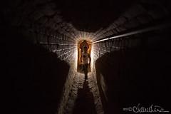 Fort Pickens tunnel (by claudine) Tags: familyphotographerwest houstonphotographybyclaudinecom fortpickensgulfshoresparkemeraldcoast shadow boy flashlight light flickrchallengegroup