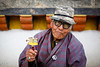 Pray (Lil [Kristen Elsby]) Tags: travel portrait man temple asia bhutan buddhist prayer pray buddhism mani prayerwheel handheld getty gho prayers gettyimages bhutanese topv7777 bumthang travelphotography jakar canon2470f28l maniwheel canon247028l lhakhang kingofbhutan maniprayerwheel canon5dmarkii jambaylhakhang handheldprayerwheel