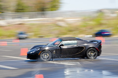 Lotus (Copious Photography) Tags: auto black sports wet water car race drive automobile track driving lotus cone pad slide spray class course vehicle drift skid advanced skidpad