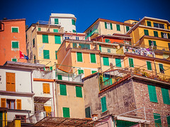 Riomaggiore / Cinque Terre (miemo) Tags: travel houses windows italy cliff buildings town spring colorful europe italia exterior village liguria hill terraces laundry balconies cinqueterre walls riomaggiore