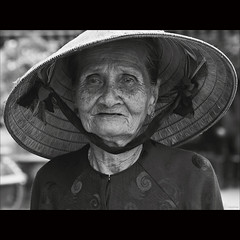 Sadness [ EXPLORED ] (-clicking-) Tags: life old portrait blackandwhite bw woman monochrome sadness blackwhite mood dof sad faces emotion bokeh details country traces streetportrait vietnam age oldwoman aged feeling oldage visage oldtime nocolors oldmother nnl blinkagain vietnamesemothers bestofblinkwinners