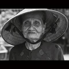 Sadness [ EXPLORED ] (-clicking-) Tags: life old portrait blackandwhite bw woman monochrome sadness blackwhite mood dof sad faces emotion bokeh details country traces streetportrait vietnam age oldwoman aged feeling oldage visage oldtime nocolors oldmother nónlá blinkagain vietnamesemothers bestofblinkwinners