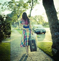 moving out (Andy Kennelly) Tags: film fashion zeiss out moving colorful dress hasselblad sidewalk carl suitcase