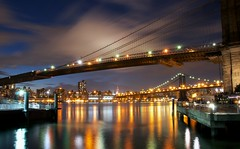 Bridges (DPGold Photos) Tags: nyc longexposure bridge ny newyork reflection building skyline brooklyn night lights cityscape manhattan empire brooklynbridge manhattanbridge empirestatebuilding dpgoldphotos