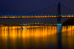 Golden Bridge Reflections (SunnyDazzled) Tags: city longexposure bridge newyork water night reflections river landscape gold lights golden cityscape skyscrapers manhattan hudson nightsky georgewashington gwb