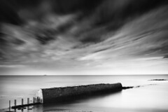 Broken Wall (Ger208k) Tags: longexposure ireland sea dublin seascape wall clouds blackwhite harbour rush breached bigstopper