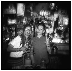 Bollocks bar staff (-ciaran) Tags: barcelona girls party bw white black blur cute 120 6x6 film fashion night mediumformat glasses holga cool lomo spain tits slow trix tattoos trendy shutter beanie montone bollocks greyscale barstaff