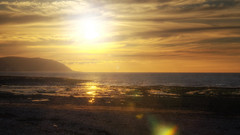 Dreamy Sunset.. (Philip R Jones) Tags: sunset sun hdr flare lensflare rock rocks rockpool minehead sea seaside