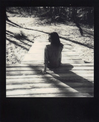 """Well I have to go."" (H o l l y.) Tags: impossible project polaroid analog instant film black frame bw no color white girl porch summer sitting fashion shadow light retro indie vintage"
