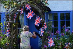 An English Village Fair 2016 (Di's Free Range Fotos) Tags: peaslakevillagefair2016 villagecottage flags unionjacks documentary photojournalism caring courtesy greeting peaslake surrey england english