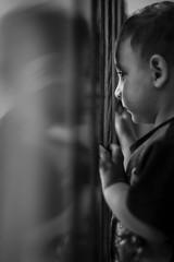 Imprisoned (Paolo Laino) Tags: canon bw bianconero bianco nero blackwhite 5dmarkiii bokeh gate reflection kid bambino riflesso dof f14 zenit helios