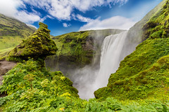 Skogafoss is a waterfall situated in the south of Iceland (tvrdypavel) Tags: landscape skógafoss awe beautiful blue central cliff countries day destinations driver europe european extremeterrain eyjafjallajokull falling fallingwater famous famousplace flowing glacier green gulfoss iceland idyllic large magnificent majestic moss mountain nature nordic northern outdoor outdoors place rainbow rapid relaxation river rock scandinavia scene scenic skogaa skogafoss skogafosswaterfall south speed spray stream summer tourism tranquil travel traveldestinations vacation water waterfall wildernessarea wonderfull world is