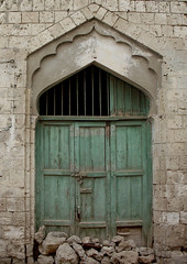 Ottoman Door In Massawa, Eritrea (Eric Lafforgue) Tags: africa door color colour building window vertical architecture outdoors photography day redsea nopeople doorway ottoman decline turkish oldfashioned massawa eritrea hornofafrica coastaltown eastafrica batsi eritreo ottomanempire buildingexterior colorpicture erytrea eritreia italiancolony massaua  massaoua ertra 0271    eritre eritreja eritria colourpicture  rythre africaorientaleitaliana ottomanturks     eritre eritrja  eritreya  erythraa erytreja     mitsiwa italiancolonialempire batseisland