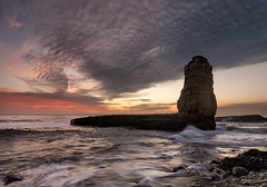 Four Mile Monolith (Shane Venem) Tags: sunset rock clouds surf monolith fourmilebeach olympuse410 zuiko918 shanevenem