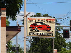County Brake Service Plastic Sign with Red Sports Car on Kirkwood Rd. in Kirkwood, MO_P5214520 (Wampa-One) Tags: missouri plasticsign redsportscar kirkwoodmo kirkwoodrd countybrakeservice