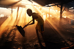 Ulingan, Tondo - The Rays that lifted my spirit (Mio Cade) Tags: poverty boy ray factory child play smoke philippines poor charcoal manila labour worker dust tondo ulingan