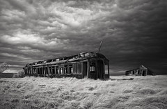 Comertown (Rodney Harvey) Tags: railroad blackandwhite storm abandoned hail train montana oldhouse railcar infrared haunting prairie apocalyptic ghostown bigskycountry