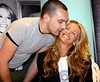 ELLE MACPHERSON being kissed by a fan at the Brown Thomas store to launch the 'Fashion Targets Breast Cancer in Ireland' campaign.Dublin, Ireland
