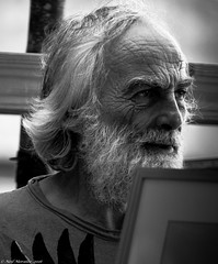 Painting By-Numbers (Neil. Moralee) Tags: man old mature painter artist beard hair balding receeding picture portrait working black white bw blackandwhite mono monochrome nikon d7100 18300mm face intent intense bushy candid day light available neil moralee close