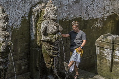 Goa Gajah bathing temple (tmeallen) Tags: man local attire sarong headscarf udeng hindu bathingtemple stoneangels fountain bathingfeet goagajah elephantcave ubud bali indonesia hot day culture
