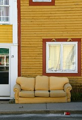 Outdoor Living (Karen_Chappell) Tags: yellow sofa couch chair house rowhouse downtown city urban stjohns jellybeanrow window wood wooden paint painted clapboard furniture