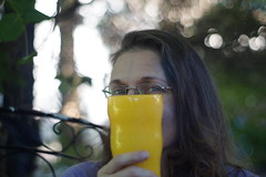 Portrait Test - Shy subject (Dan The Hutt) Tags: minoltamdrokkorx50mmf17 unprocessed pixelpeeper eyes yellow cup