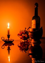 Romantic Warmth (Paul Calcutt) Tags: candle light grapes still life reflection canon 7d wine brass tabletop flicker