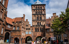 2016 - Baltic Cruise - Lbeck Germany - Castle Gate 1 (Ted's photos - For Me & You) Tags: 2016 cropped germany lubeck tedmcgrath tedsphotos vignetting castlegate castlegatelubeck lbeckgermany gate arches brick redbrick streetscene street unesco unescoworldheritagesite