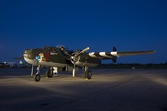 Dusk has fallen and the lights are up (Stephen Gardiner) Tags: hamilton ontario 2016 canadianwarplaneheritagemuseum lancster flyingfortress mitchell worldwar2 b17 b25 avro boeing northamericanaviation night plane aircraft propeller noseart pentax k3ii 1645