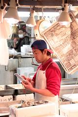 Tsukiji Fish Market | Texting Time (Toni Kaarttinen) Tags: japan  japonia    jap japonsko jaapan  japani japon xapn    japn jepang an tseapin giappone  japna japonija  japo  japonska japn hapon  japonya nht bn tokyo tokio japanese tsukijifishmarket tsukiji fish market fishmarket man guy boy iphone mobile