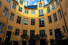 Danish Courtyard (Mabry Campbell) Tags: windows color detail yellow architecture floors copenhagen denmark photography march photo europe apartments interior fineart courtyard capitol danish 100 24mm f80 asymmetrical levels oval ef2470mmf28lusm offices 2012 cirlce capitolcity circlular architectualdetail smallcourtyard ¹⁄₈₀sec mabrycampbell march62012 201203065568