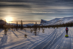 Sunset over Sarek (Greg Annandale) Tags: trees sunset orange mountain snow ski mountains landscape sweden tracks arctic wilderness pulk skitour sarek pulka skierfe norrbottencounty