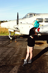 I've landed where I want to stay (DewDrop17) Tags: light sky sun art fashion metal plane airplane photography flying high interesting colorful punk legs boots artistic machine content aeroplane dreaming cannon dreamy parked bluehair takingflight confident icollectlight redhotchilipepperslovers