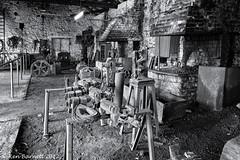 Blacksmiths Shop Mono (K_D_B (One Eye On The Sky)) Tags: bw wheel metal canon mono blackwhite decay rusty vice coke rusted forge coal decaying anvil 30d bigpit blacksmithsshop tressel kdb blaenavon nationalminingmuseum sigma1770f28dcosmacro
