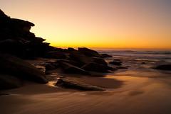 Tamarama Beach (Kokkai Ng) Tags: longexposure morning travel sea beach nature water rock horizontal sunrise landscape dawn twilight sand australia nobody newsouthwales clearsky tamarama blurredmotion sydneyaustralia rockycoastline tamaramabeach coastalfeature