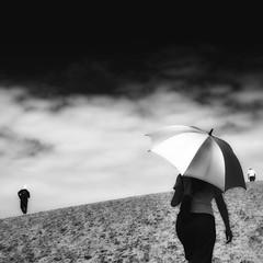 all paths lead to the sea (StephenCairns) Tags: ocean sea blackandwhite bw japan contrast umbrella three sand dune 日本 雲 sanddune 散歩 tottori 傘 白黒 鳥取砂丘 三人 登る canon50d 綱 stephencairns 鳥取市 50dcanon