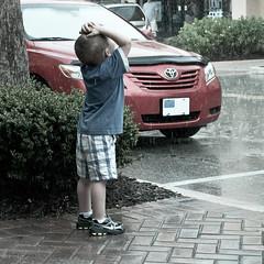 Where the Sidewalk Ends (Patti-Jo) Tags: street boy red up car rain weather kid child looking candid bricks sidewalk raining sprinkling