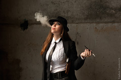 Gangster woman (SvetoGraf) Tags: 1920s people woman brown black beautiful beauty face hat vertical female umbrella hair person one gangster cool holding women hand image serious cigarette background smoke young posing tie style lips smoking human crime jacket pistol only sensuality adults mafia holder imagery elegance femininity 19401980 retrostyled