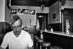the reader (Sally E J Hunter) Tags: toronto vintage reading blackwhite noiretblanc candid diner gales homme luncheonette ruggero easternavenue carlaw galessnackbar racca