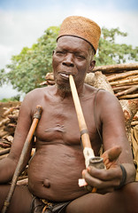 Taneka Beri fetisher smoking traditional pipe. Pays Taneka, Benin (NeSlaB ф.) Tags: poverty africa old portrait men look fetish canon religious photo ancient traditional faith religion pipe culture photojournalism oldman tribal smoking clothes priest benin tribe ethnic voodoo developingcountries reportage nationalgeographic ethnography ethnology beri goatskin ouest ethnies taneka atakora fetisher neslab tangba