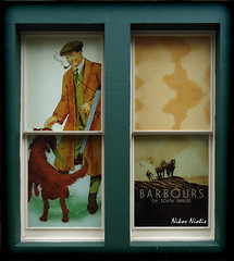 Scottish Style (Nikos Niotis) Tags: old uk greatbritain dog man green window monument shop architecture square photography scotland edinburgh south traditional scottish style advertisement clothes custom barbour leafs brand shields barbours flickrstruereflection1