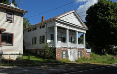 Mount Liberty Tavern  Mount Liberty, Ohio (Pythaglio) Tags: house dwelling residence historic greek revival mount liberty mtliberty ohio county knox township 15story braced frame pediment temple entablature triglyphs mutules doric columns porch brick basement operable shutters 96 windows wood siding white chimneys magnificent splendid lovely gravel street road slope hill bushes trees sky blue cables wires ca1832 tavern samuel thatcher nrhp national register places 74001539 kno29012