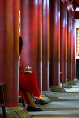 the woman in red (jolantamazur) Tags: woman red colorcoordinated column rowofcolumns pattern repetition chinatown chinesetemple singapore noface mysterious candid colonnade
