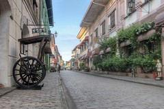 street (nald_babaran) Tags: brickroad filipino philippines morning clouds people horsecarriage statue heritage prehispanic blue sky decay architecture design eos hdr canon hotelwithpool wheel alley
