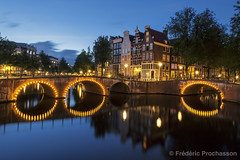 Amsterdam Canal by night (Prochasson Frdric) Tags: amsterdam canal holland night nederland benelux red landmark mood illuminated yellow copyspace orange old picturesque historic kanaal moody lighttrails architecture color bluehour colorful motion lit illumination house golden nightlife cityscape netherlands gracht colourful european evening glow dusk keizersgracht colour city blue dutch romantic water bridge europe taillights capital